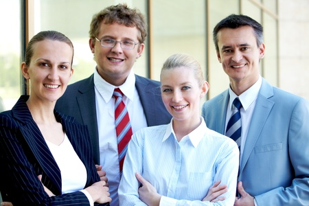 Portrait of confident business leaders looking at camera with smiles photo