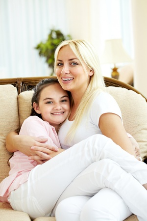 Portrait of happy mother and daughter embracing  Stock Photo - 9817842