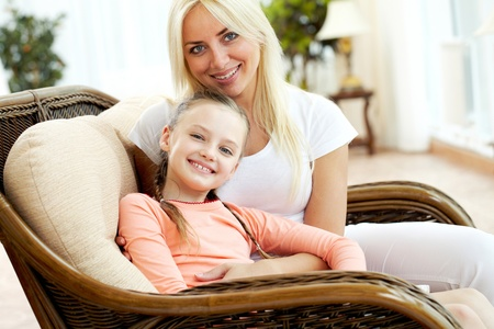 Portrait of happy mother embracing daughter and both looking at camera Stock Photo - 9819119