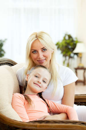 Portrait of happy mother embracing daughter and both looking at camera Stock Photo - 9819507