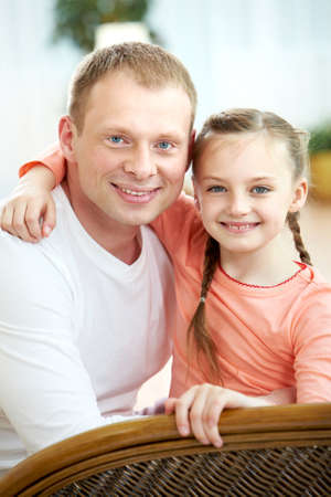 Portrait of happy father embracing daughter and both looking at camera Stock Photo - 9819440