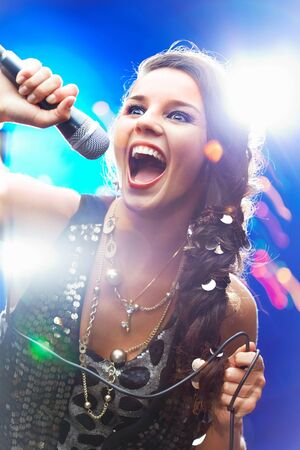 Portrait of a glamorous girl singing Stock Photo - 9817838