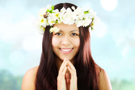 Image of happy female wearing floral wreath on head photo