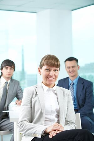 A beautiful businesswoman looking at camera in working environment Stock Photo - 9819369