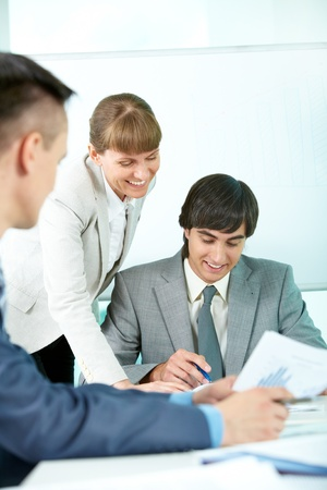 Portrait of smiling partners looking through papers in office Stock Photo - 9819362