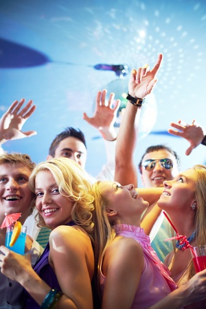 disco girls: Portrait of cheerful friends dancing and having fun at party in club Stock Photo