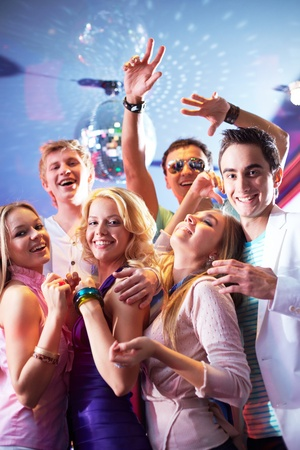 dancing club: Portrait of glamorous friends dancing at party in club Stock Photo