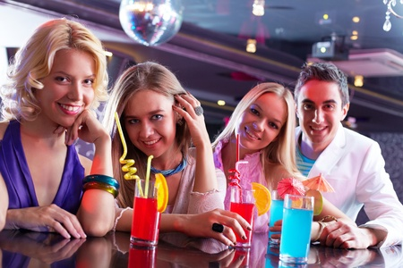 Portrait of happy girlfriends holding glasses with cocktails Stock Photo - 9819367