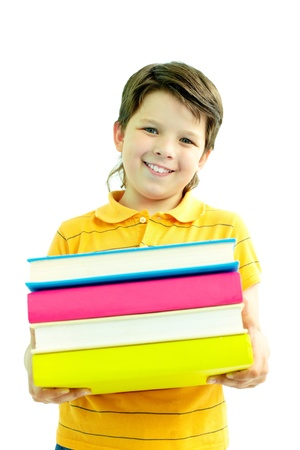 Portrait of happy boy with stack of books looking at camera photo