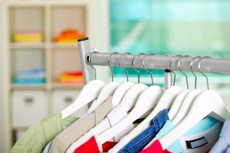 Photo of hangers with different clothes in department Stock Photo - 9804394