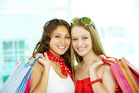 Portrait of happy shoppers with paperbags looking at camera Stock Photo - 9818580