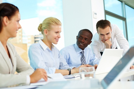 Several business people planning work in office photo