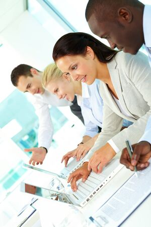 Group of business people planning work in office photo