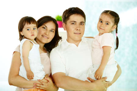 Portrait of happy parents with daughters looking at camera Stock Photo - 9817596
