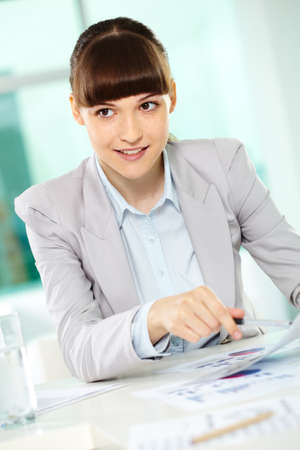 Portrait of smiling businesswoman looking aside during discussion Stock Photo - 9806860