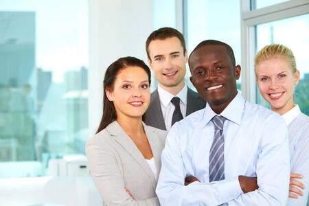 company employee: Group of confident business partners looking at camera
