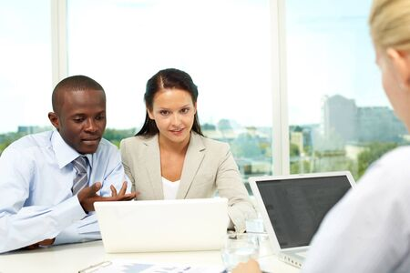 Portrait of two business partners networking at meeting Stock Photo - 9908854