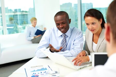 Portrait of two business partners networking in office Stock Photo - 9908867