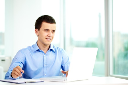 Portrait of successful businessman working on computer Stock Photo - 9910456