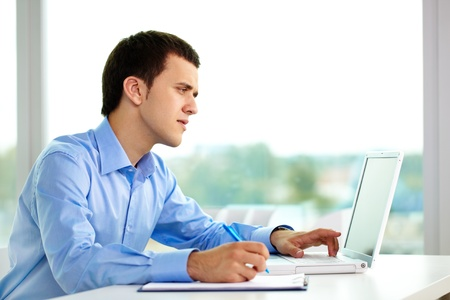 Portrait of successful businessman working on computer in office Stock Photo - 9910462