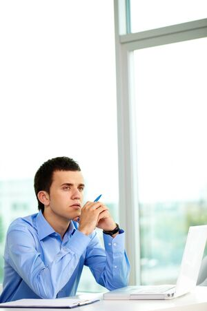 Portrait of pensive businessman thinking of ideas in office Stock Photo - 9910450