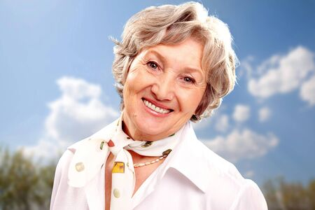Portrait of stylish woman grey haired looking at camera photo