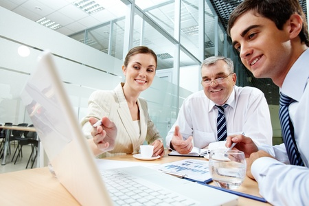 A business team of three sitting in office and planning work Stock Photo - 9910612