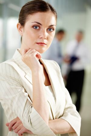 Portrait of businesswoman looking at camera in working environment photo