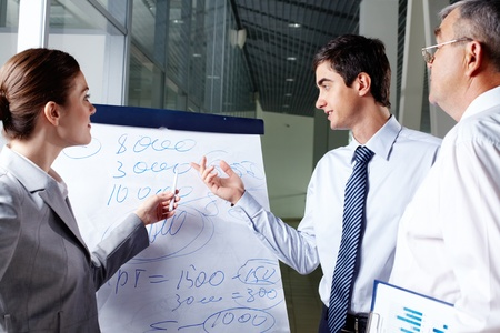 A business man and his partner discussing something on a whiteboard Stock Photo - 9910634
