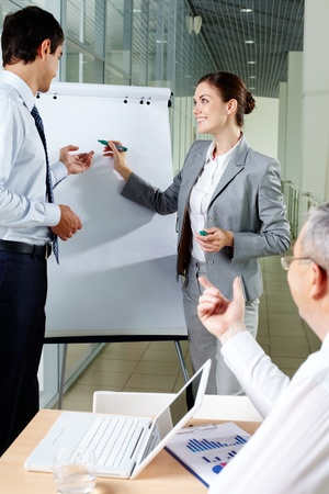 A business man and his partner standing by whiteboard and interacting Stock Photo - 9910590