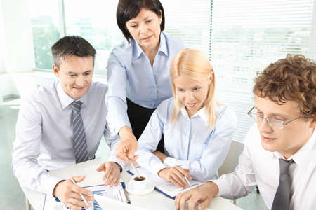 Group of business partners planning work at meeting photo