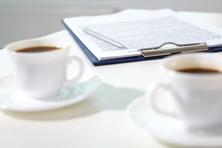 Image of contract with pen on workplace and two cups of coffee near by Stock Photo - 9910700