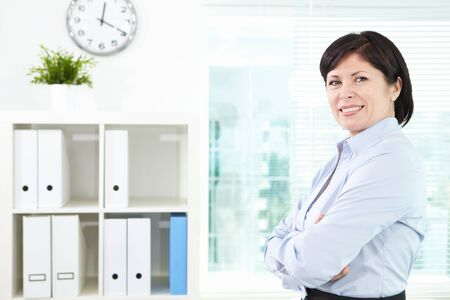 Mature businesswoman looking at camera in office photo