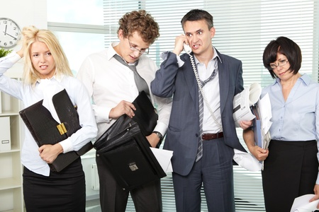 zenuwachtig: Group of tired and annoyed businesspeople after hard working day Stockfoto