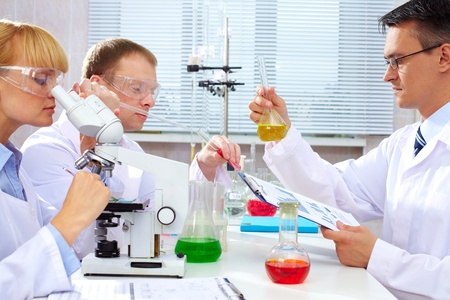 Serious clinicians studying new medicine in laboratory photo