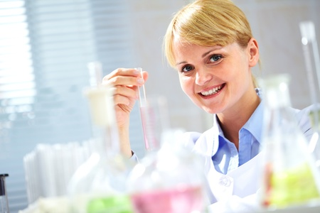 Portrait of a young scientist with tubing, looking at camera and smiling Stock Photo - 9910721