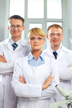 Portrait of three doctors looking at camera and smiling Stock Photo - 9910749