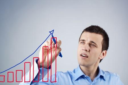 Confident businessman drawing success scheme Stock Photo - 9910756
