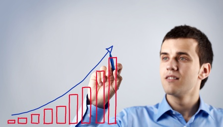 Confident businessman drawing chart of success Stock Photo - 9908859