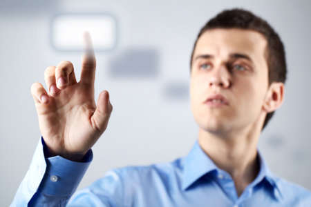 pushing the button: Confident businessman pressing button