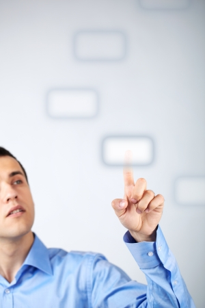 touch button: Close-up of young businessman pressing virtual button