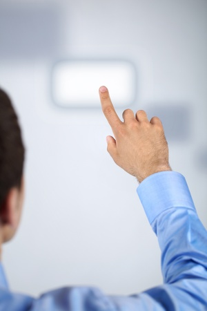 pushing the button: Male hand pressing virtual button  Stock Photo