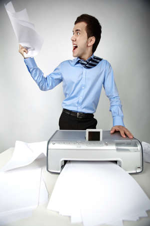 Portrait of nervous businessman at workplace with scanner on it photo