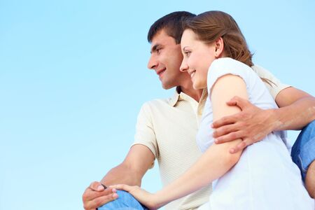 peaceful couple looking forward with blue sky on background Stock Photo - 9908728
