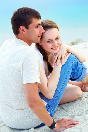 Peaceful couple enjoying summer vacation on sandy shore Stock Photo - 9910849
