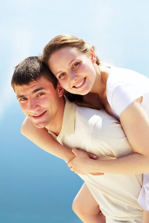 happy man giving piggyback to his girlfriend and having fun Stock Photo - 9910839
