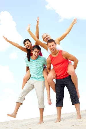 Happy company of two young men and two women on their backs  photo