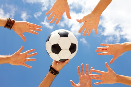 ball stretching: A football ball in circle of hands