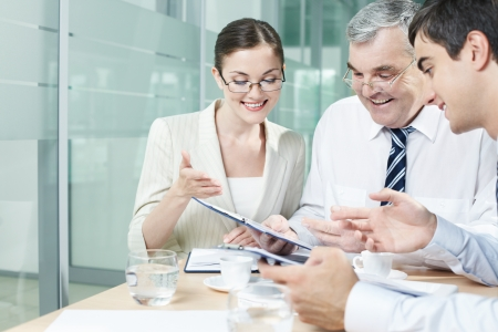 Three businesspeople holding discussion in office Stock Photo - 9963072