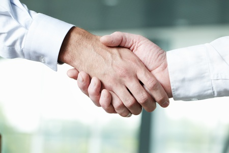 teamwork together: Close-up of two shaking male hands  Stock Photo